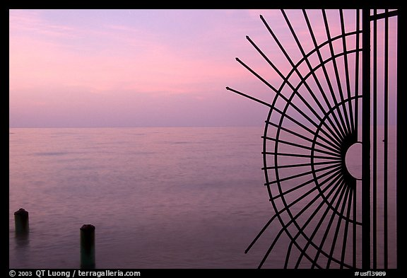 Grid and pilings and sunrise. Key West, Florida, USA (color)