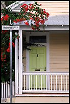 Pastel-colored house, tropical flowers, street sign. Key West, Florida, USA ( color)