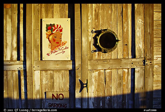 Wooden door with cuba poster. Key West, Florida, USA (color)