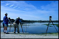 Photographers with big lenses, Ding Darling NWR, Sanibel Island. Florida, USA (color)