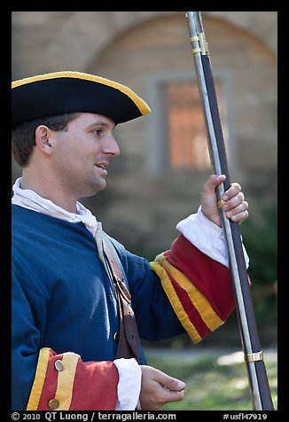 Man dressed as a Spanish soldier in the 18th century demonstrates gun, Fort Matanzas National Monument. St Augustine, Florida, USA