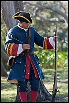 Man useing ramrod on musket, Fort Matanzas National Monument. St Augustine, Florida, USA (color)