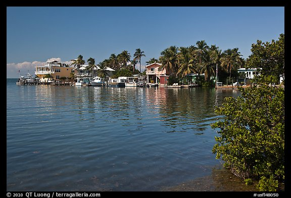Conch cottages lining edge of Florida Bay, Conch Key. The Keys, Florida, USA (color)