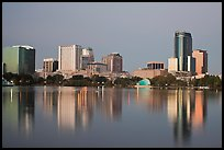 Skyline at dawn from lake Eola. Orlando, Florida, USA ( color)