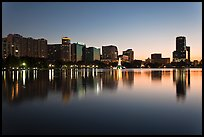 Orlando skyline at sunset reflected in lake Eola. Orlando, Florida, USA ( color)