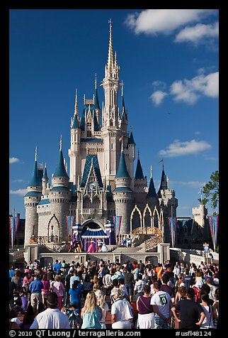 Tourists attend stage musical in front of Cindarella castle. Orlando, Florida, USA (color)