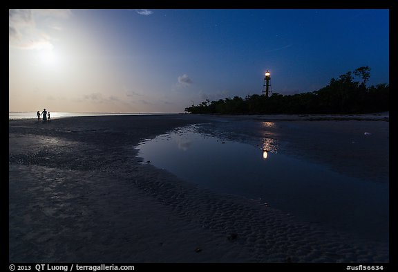Lighthouse beach with family in distance and moonlight, Sanibel Island. Florida, USA (color)