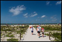 Family walking out to Bowman Beach, Sanibel Island. Florida, USA ( color)