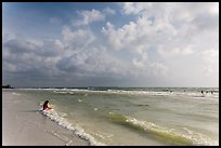 Woman sitting in water, Fort De Soto beach. Florida, USA ( color)