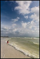 Woman and wave, Fort De Soto beach. Florida, USA ( color)