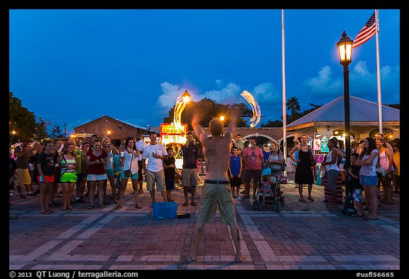 Street entertainer and spectators. Key West, Florida, USA (color)