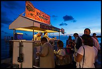 People buying food at stand on Mallory Square. Key West, Florida, USA ( color)