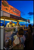Key West conch fritters food stand at sunset. Key West, Florida, USA (color)