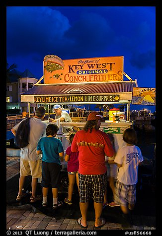 Key lime and conch fritters food stand at night. Key West, Florida, USA (color)