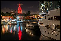 Yachts, Bayside Marketplace harbor and Freedom Tower illuminated at night, Miami. Florida, USA ( color)