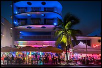 Restaurant tables and Art Deco buildings at night, Miami Beach. Florida, USA ( color)