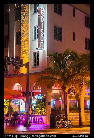 Corner street with Edison hotel, bicycle and palm tree at night, Miami Beach. Florida, USA (color)