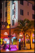 Corner street with Edison hotel, bicycle and palm tree at night, Miami Beach. Florida, USA ( color)
