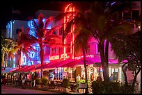 Art Deco hotels and restaurants with facades lit in bright colors, Miami Beach. Florida, USA ( color)