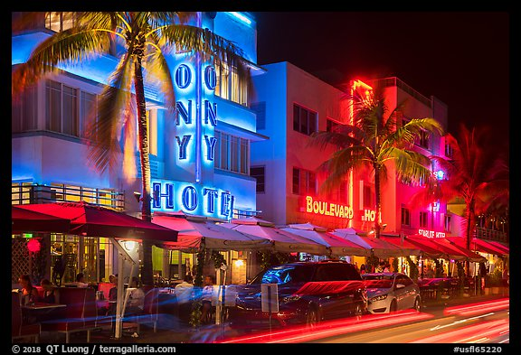 Art Deco hotels colorfully illuminated and traffic light trails, South Beach, Miami Beach. Florida, USA (color)