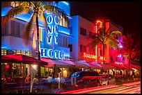 Art Deco hotels colorfully illuminated and traffic light trails, South Beach, Miami Beach. Florida, USA ( color)