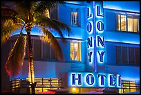 Palm tree and neon light on hotel facade, Miami Beach. Florida, USA ( color)