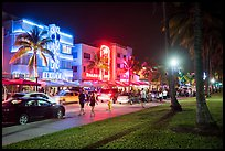 Street with row of Art Deco hotels at night, South Beach District, Miami Beach. Florida, USA ( color)