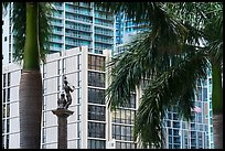 Palm tree leaves, statue, and high rises, Brickell, Miami. Florida, USA ( color)