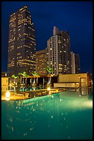 Pool surrouned by high rise towers at night, Miami. Florida, USA ( color)