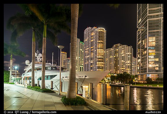 Large yacht, Miami River, and Brickell Key at night, Miami. Florida, USA (color)