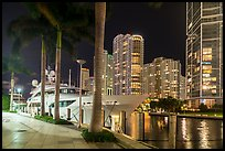 Large yacht, Miami River, and Brickell Key at night, Miami. Florida, USA ( color)