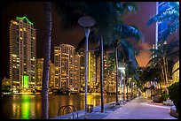 Miami Riverwalk and Miami River, Brickell district, night, Miami. Florida, USA ( color)