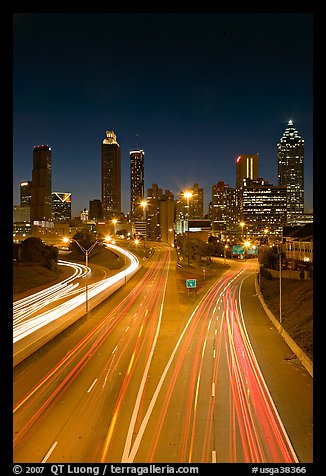 Highway and Atlanta skyline at night. Atlanta, Georgia, USA (color)