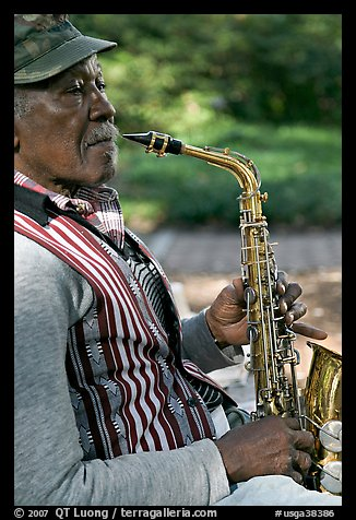 African-American musician with saxophone in square. Savannah, Georgia, USA (color)