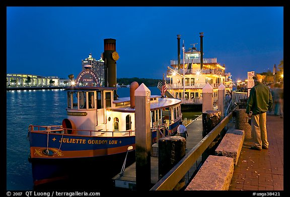 Ferry and riverboat on Savannah River at dusk. Savannah, Georgia, USA (color)