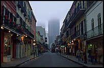 Bourbon street and the new town in the fog, French Quarter. New Orleans, Louisiana, USA (color)
