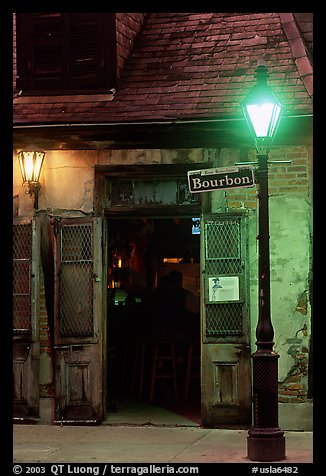 Cafe on Bourbon street at night, French Quarter. New Orleans, Louisiana, USA (color)