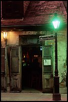Cafe on Bourbon street at night, French Quarter. New Orleans, Louisiana, USA