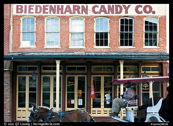 Horse carriage in front of Biedenharn Candy building. Vicksburg, Mississippi, USA (color)