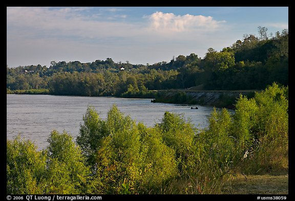 Banks of the Mississippi River with small boat. Natchez, Mississippi, USA (color)