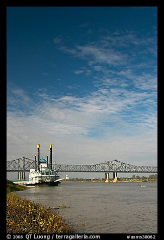 Mississippi River, paddle riverboat, and bridge. Natchez, Mississippi, USA (color)