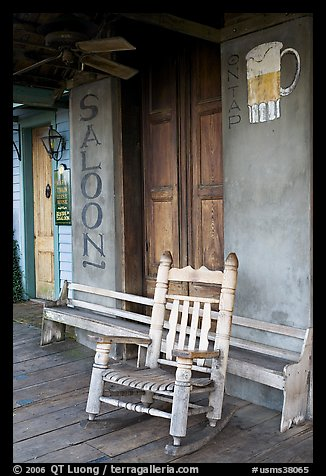 Rocking chair on saloon porch, Natchez under-the-hill. Natchez, Mississippi, USA (color)