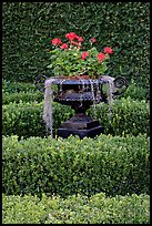 Vasque with flowers and spanish moss in garden. Natchez, Mississippi, USA (color)