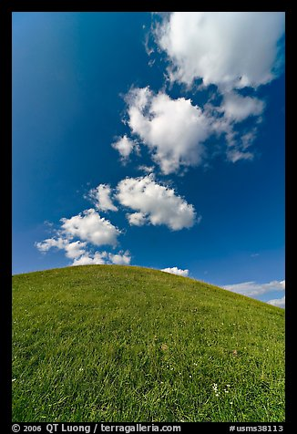 Rounded hill and clouds,  Emerald Mound. Natchez Trace Parkway, Mississippi, USA (color)