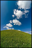 Rounded hill and clouds,  Emerald Mound. Natchez Trace Parkway, Mississippi, USA