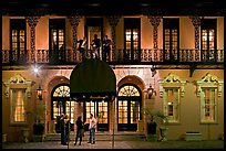 Mills house hotel facade with balconies at night. Charleston, South Carolina, USA