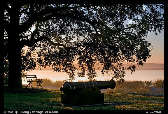 Cannon, and bench overlooking Beaufort Bay at sunrise. Beaufort, South Carolina, USA (color)