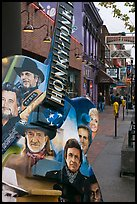 Guitar-shaped sign with images of famous singers on Broadway sidewalk. Nashville, Tennessee, USA ( color)