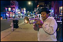 Jazz Street Musician on Beale Street by night. Memphis, Tennessee, USA