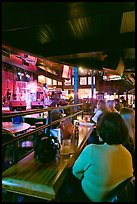Patrons listen to musical performance in Beale Street bar. Memphis, Tennessee, USA